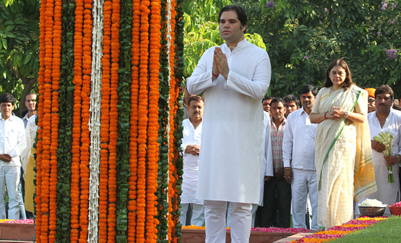 NEW DELHI, INDIA - JUNE 23: Union Minister for Women and Child Development Maneka Gandhi and son Varun Gandhi paying floral tributes to Late Sanjay Gandhi on his death anniversary at Shantivan on June 23, 2015 in New Delhi, India. (Photo by Arvind Yadav/ Hindustan Times via Getty Images )