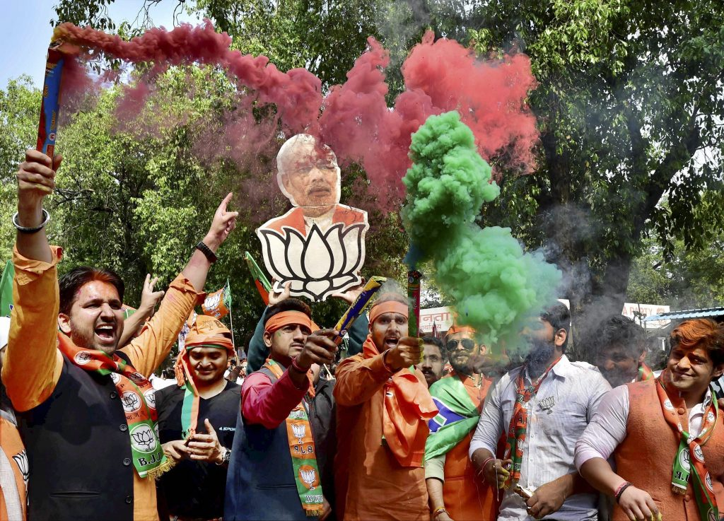 New Delhi: BJP supporters and workers celebrate the party's victory in the assembly elections with colours, at party headquarters in New Delhi on Saturday. PTI Photo by Kamal Kishore (PTI3_11_2017_000052B)