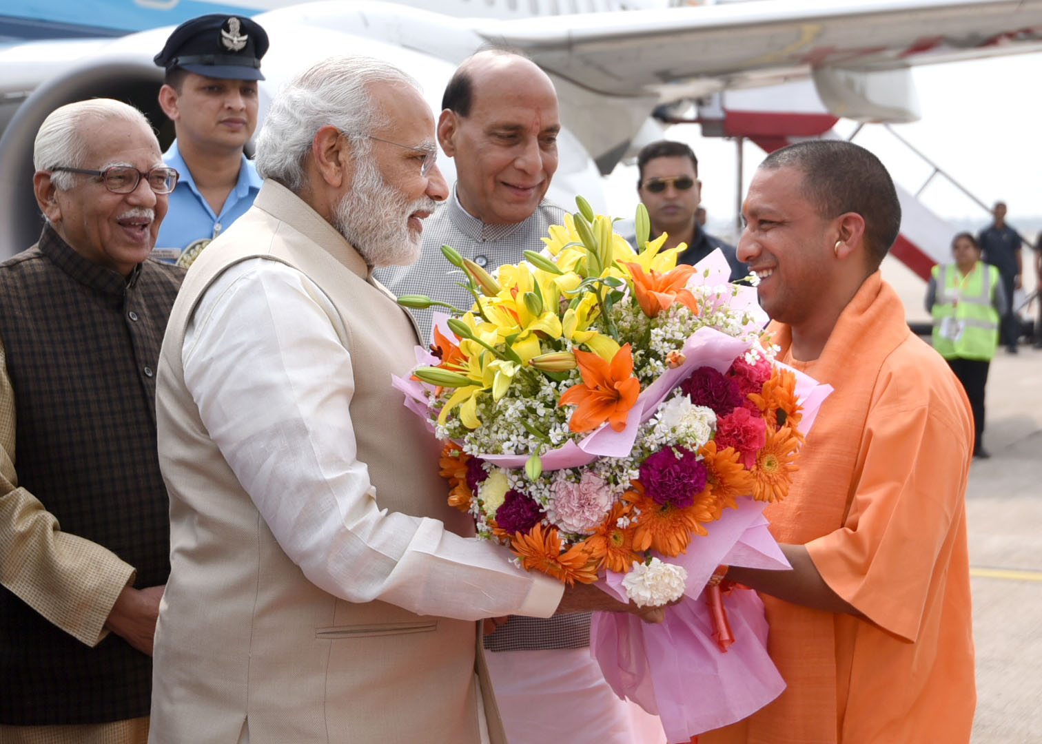 The Prime Minister, Shri Narendra Modi being received by the Governor of Uttar Pradesh, Shri Ram Naik, the Union Home Minister, Shri Rajnath Singh and the Uttar Pradesh Chief Minister designate Yogi Adityanath, on his arrival, at Lucknow, Uttar Pradesh on March 19, 2017.