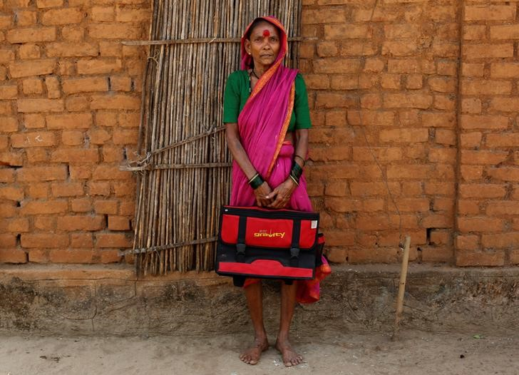 Drupada Pandurangkedar, 70, who studies at Aajibaichi Shaala (Grandmothers' School), poses for a photograph outside her house in Fangane village, India, February 15, 2017. REUTERS/Danish Siddiqui