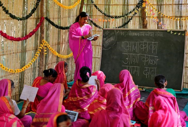 Sheetal Prakash More (R), a 30-year-old teacher, teaches at Aajibaichi Shaala (Grandmothers' School) in Fangane village, India, February 15, 2017. REUTERS/Danish Siddiqui