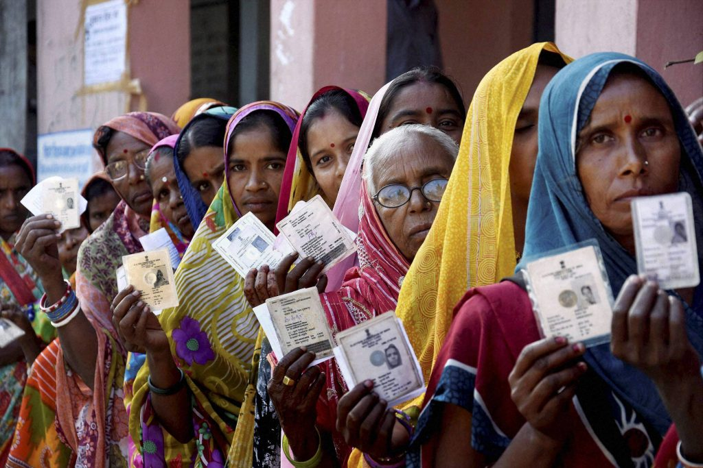 Muzaffarpur : Women voters wait in a queue to cast their votes during fourth phase of Bihar elections in Muzaffarpur on Sunday. PTI Photo (PTI11_1_2015_000133B)