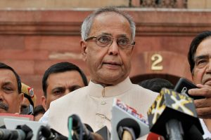 India's Finance Minister Pranab Mukherjee speaks to the media outside his office before submitting his resignation from his post to contest in the Indian presidential election in New Delhi June 26, 2012. REUTERS/Adnan Abidi (INDIA - Tags: POLITICS ELECTIONS) - RTR3465C