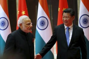 Chinese President Xi Jinping (R) guides Indian Prime Minister Narendra Modi to a meeting room in Xian, Shaanxi province, China, May 14, 2015.  REUTERS/Kim Kyung-Hoon