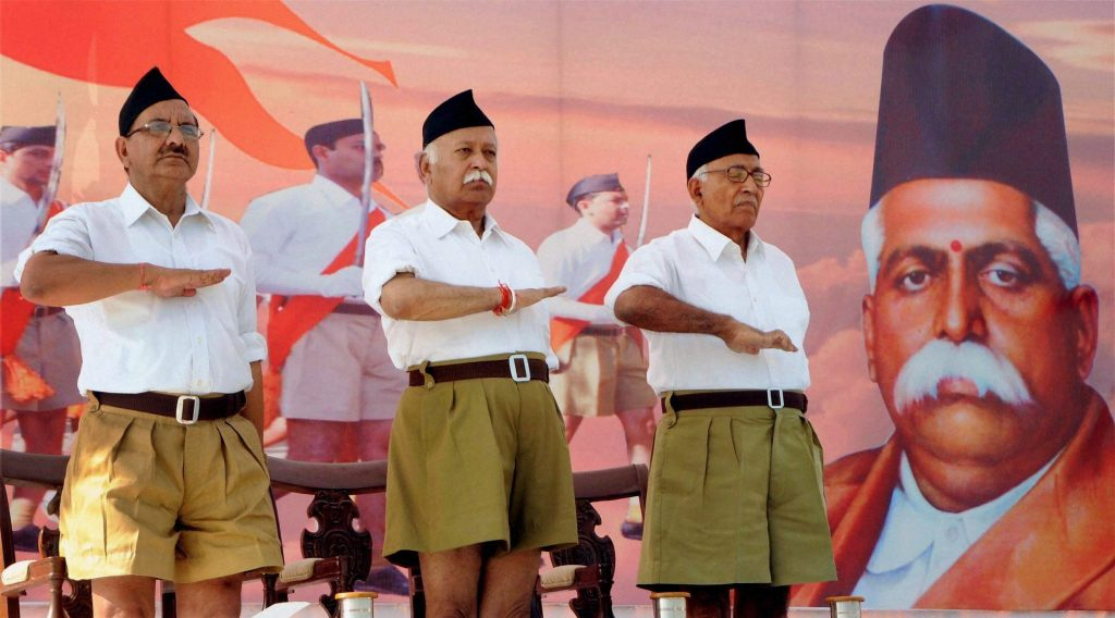 New Delhi: File photo of RSS Chief Mohan Bhagwat (C) during the RSS function. Khaki shorts, the trademark RSS dress for 91 years, is on its way out, making way for brown trousers, the significant makeover decision was taken here at an RSS conclave in Nagaur, Rajasthan on Sunday. PTI Photo (PTI3_13_2016_000268B)