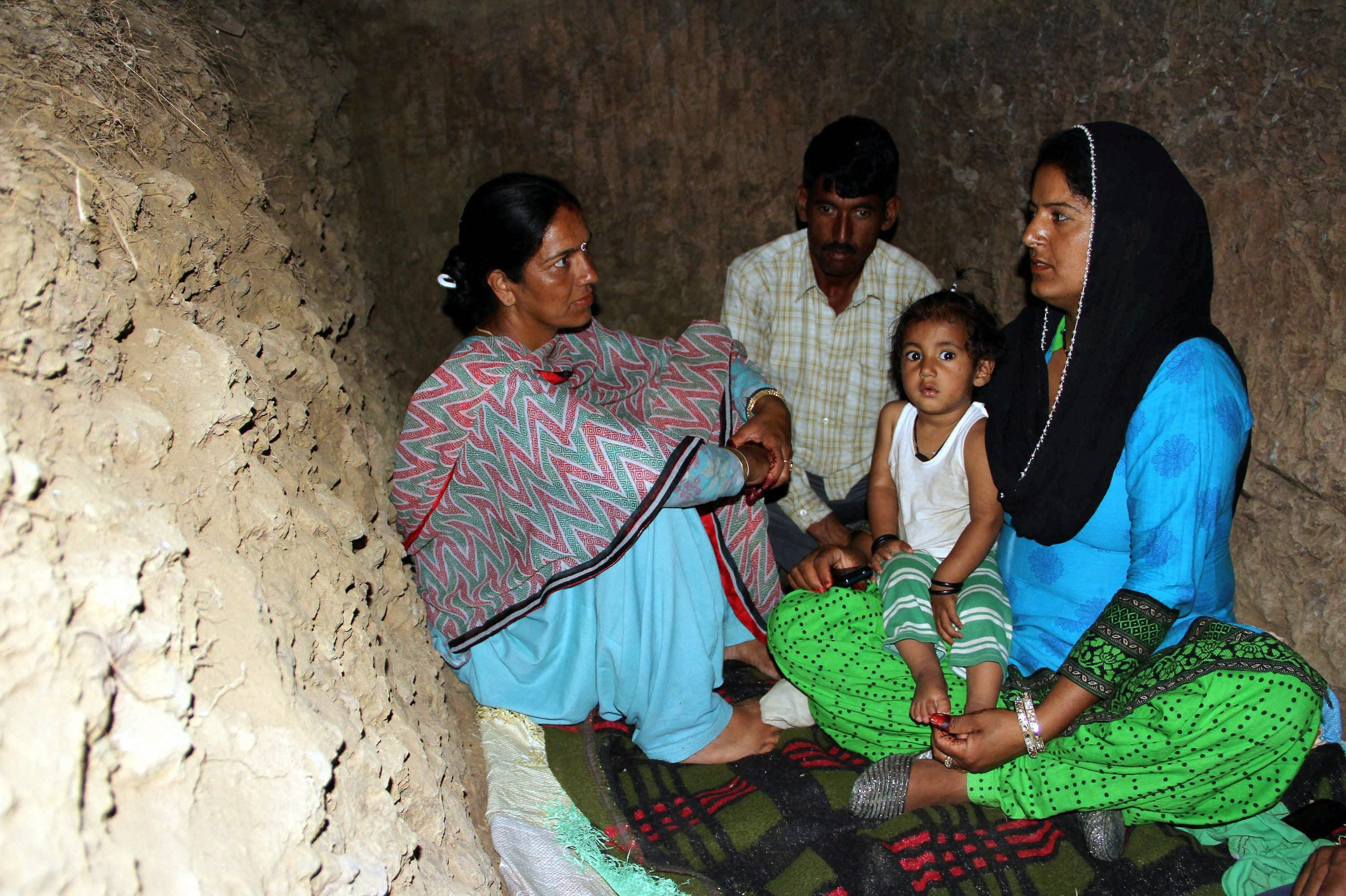 Rajouri: Border migrants take shelter in a bunker after shelling from Pakistan side at Nowshera sector of Rajouri district on Saturday. PTI Photo(PTI5_13_2017_000146A)