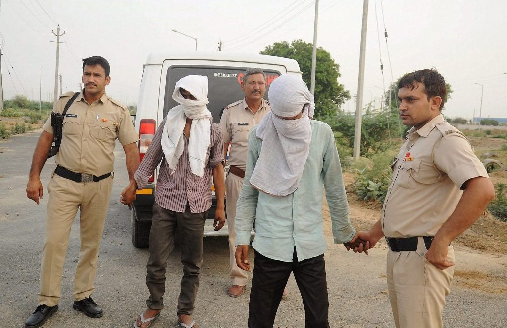 Rohtak: Police take the accused to the scene of crime where the brutally mutilated body of a woman was dumped after she was abducted, gang-raped and murdered, in Rohtak on Sunday. PTI Photo (PTI5_14_2017_000140A)