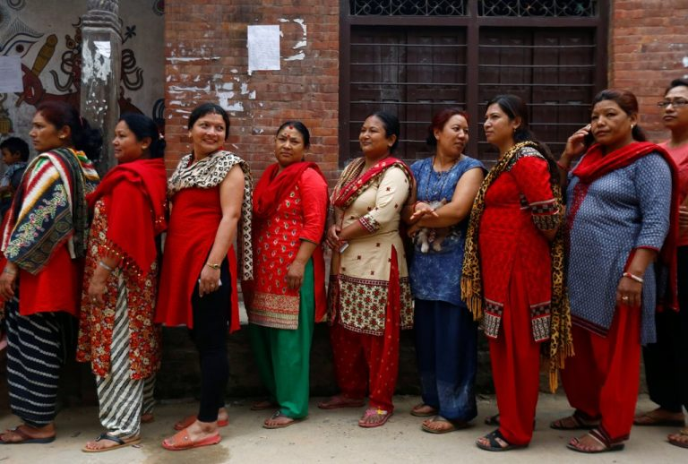People queue to cast their votes during the local election of municipalities and village representatives in Thimi, Nepal May 14, 2017. REUTERS/Navesh Chitrakar