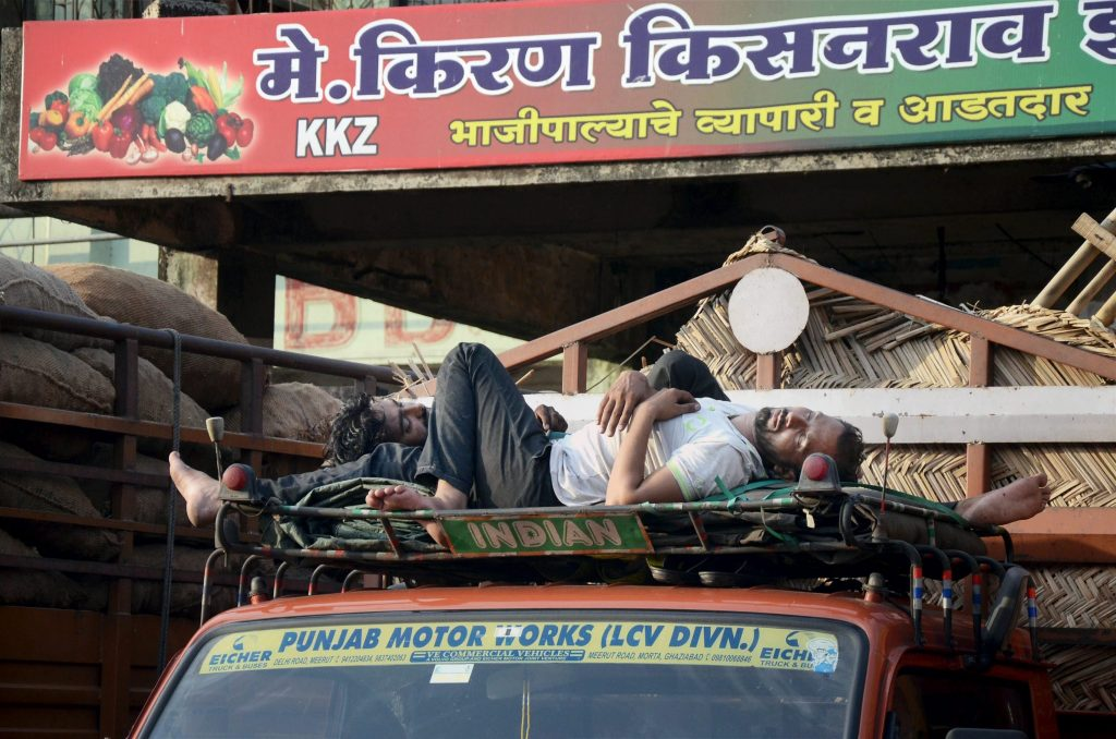 Navi Mumbai: A driver takes nap on a truck ar APMC Vegetable Market on the second day of farmers' strike in Navi Mumbai on Friday. PTI Photo (PTI6_2_2017_000114B)