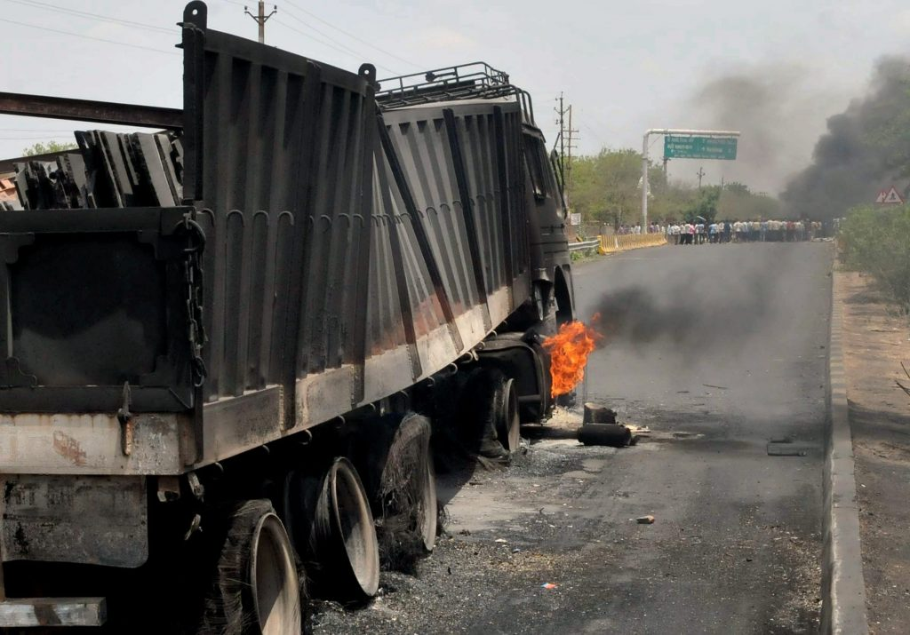 Mandsaur: Farmers' agitation turns violent as they torch trucks at Mhow-Neemuch Highway in Mandsaur district of Madhya Pradesh on Wednesday. PTI Photo(PTI6_7_2017_000106A)