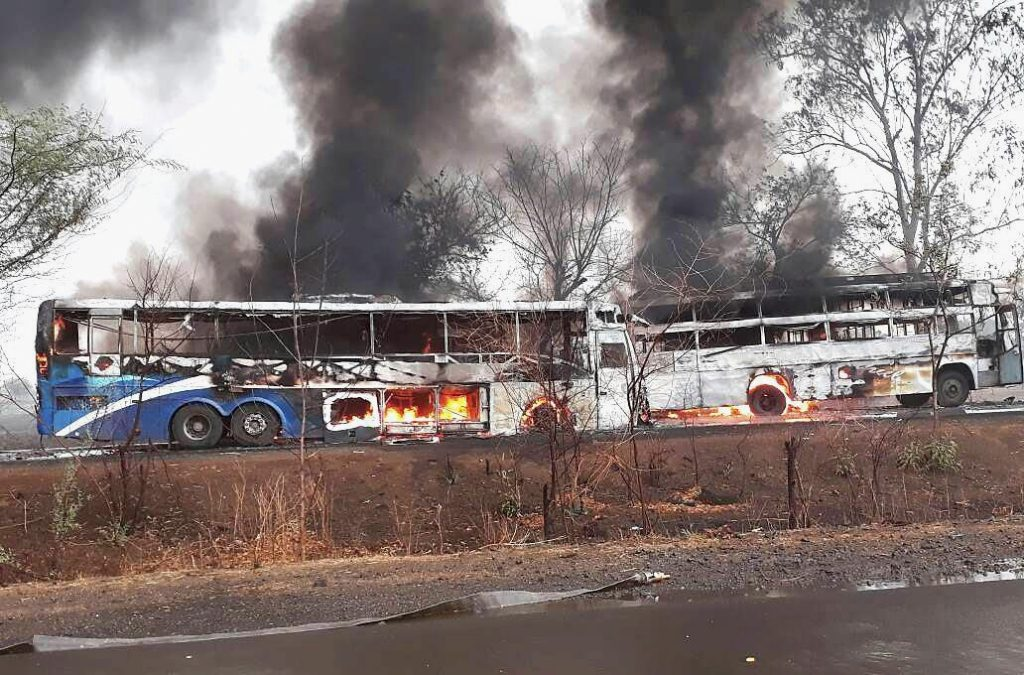 Dewas : The charted buses which were torched by farmers at Nevri Fata in Dewas district on Wednesday. PTI Photo  (PTI6_7_2017_000181A)