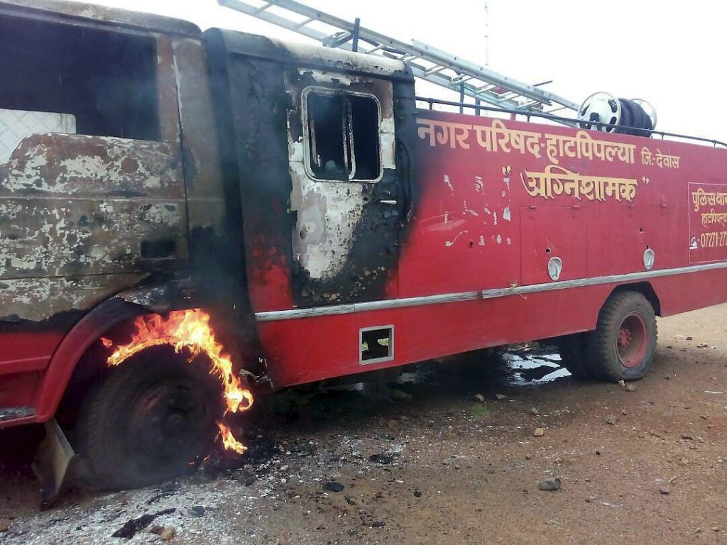 Dewas: A fire tender that was was torched by the farmers during their agitation in Dewas district on Wednesday. PTI Photo (PTI6_7_2017_000194A)