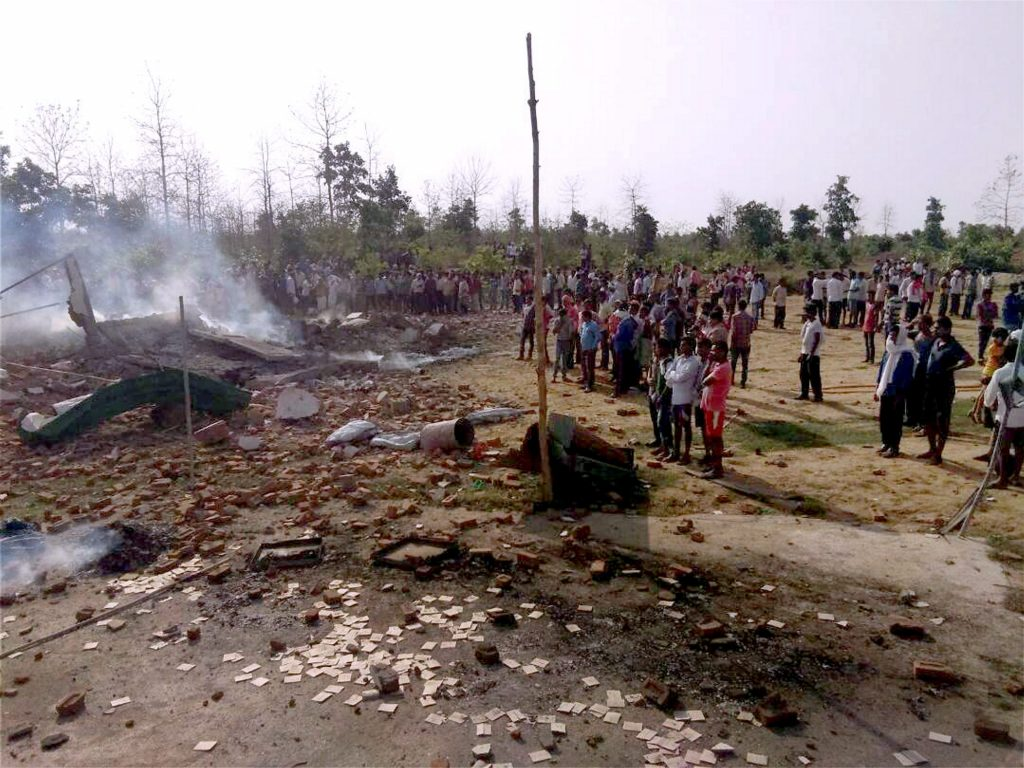 Balaghat : People gather near the site of a blast that took place in fire crackers factory at Balaghat, Madhya Pradesh on Wednesday. PTI Photo (PTI6_7_2017_000234B)