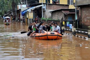 Guwahati: Residents of Anil Nagar and Nabin Nagar being evacuated by State Disaster Respond Force (SDRF) from  flood affected areas in Guwahati on Wednesday. The district  administration had ordered closure of government and private schools and colleges today. PTI Photo(PTI6_14_2017_000032B)