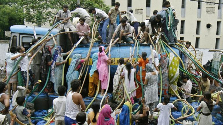 residents-containers-sanjay-colony-delhi-their-water_reuters