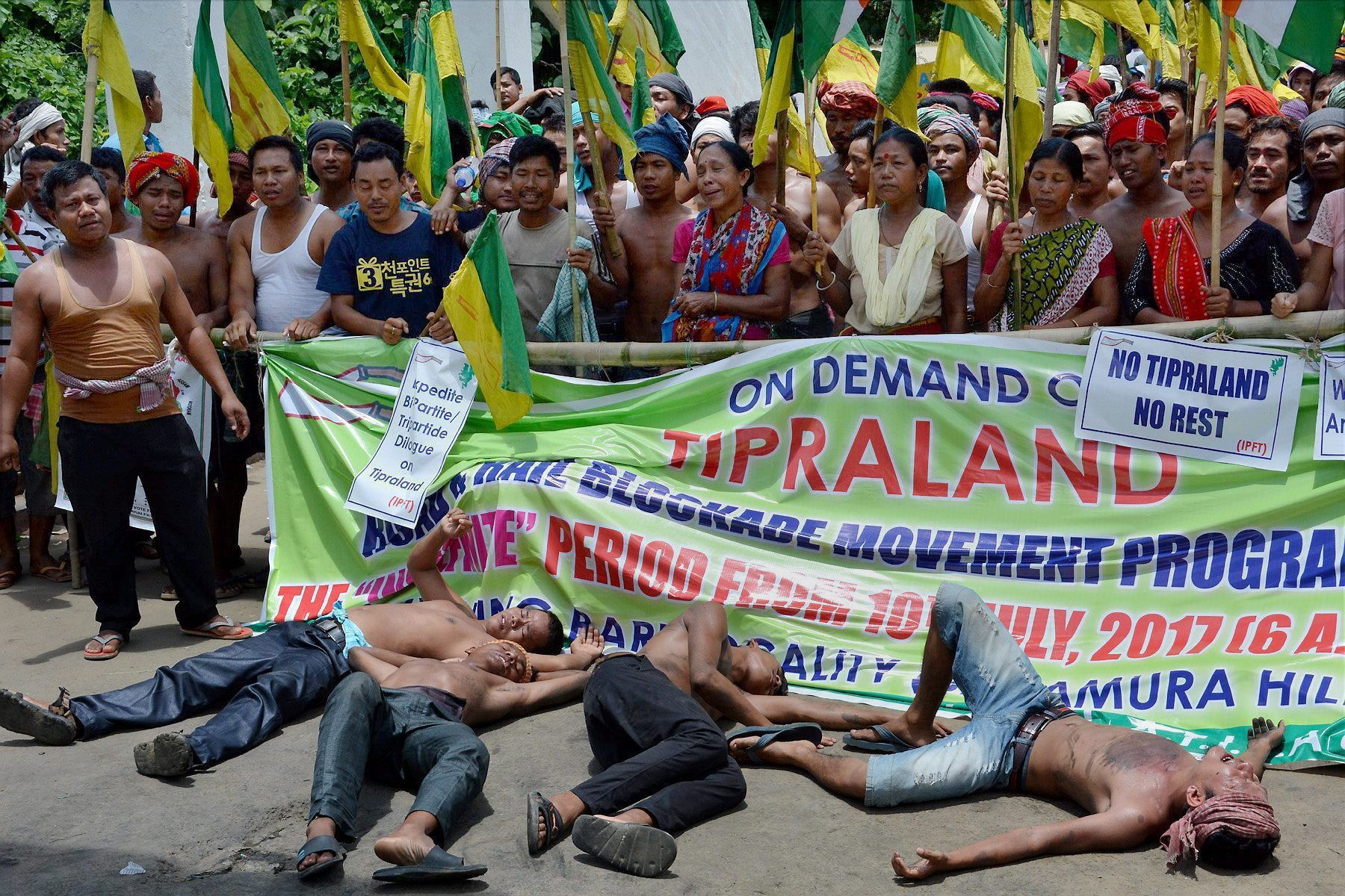 Agartala: Supporters of Indigeneous Peoples Front of Twipra (IPFT) shout slogans as they block national highway (NH-44) to demand for a separate of Tipraland state at Khamtingbari, Baramura Hill range, some 36 km north of Agartala on Sunday. PTI Photo (PTI7_16_2017_000285A)