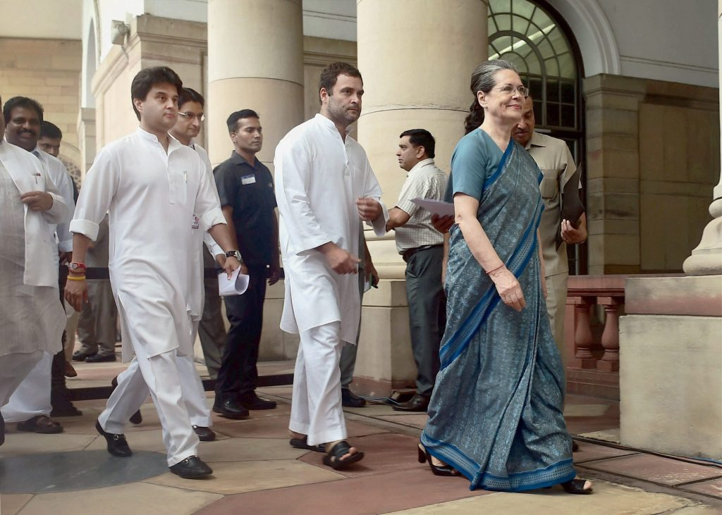 New Delhi: Congress president Sonia Gandhi with party Vice president Rahul Gandhi and MP Jyotiraditya Madhavrao Scindia arrives to cast vote in the Presidential Election, in New Delhi on Monday. PTI Photo by Manverder Vashist(PTI7_17_2017_000041a)
