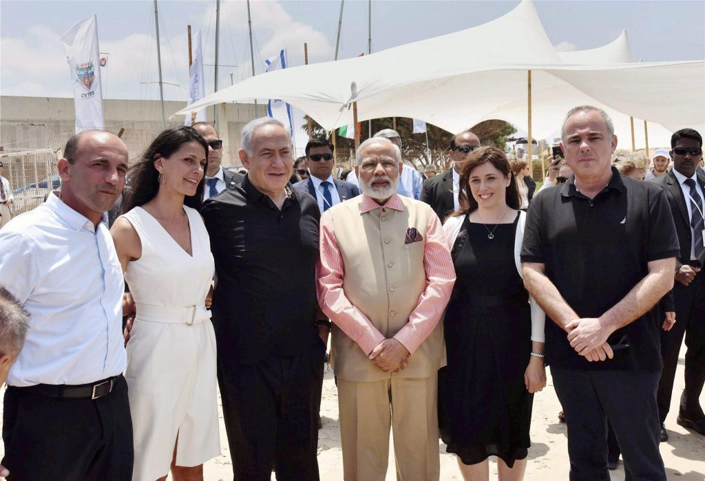 Olga Beach: Prime Minister Narendra Modi with his Israeli counterpart Benjamin Netanyahu and others during a visit to the Olga Beach in Israel on Thursday. PTI Photo / PIB (PTI7_6_2017_000121A)