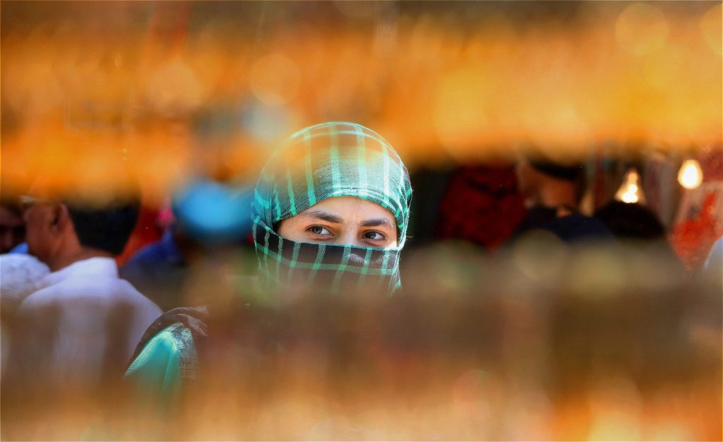 Jaipur: A Muslim woman shopping for the upcoming Eid-ul-Fitr festival at Ramganj Bazar in Jaipur on Thursday. PTI Photo(PTI6_22_2017_000148B)