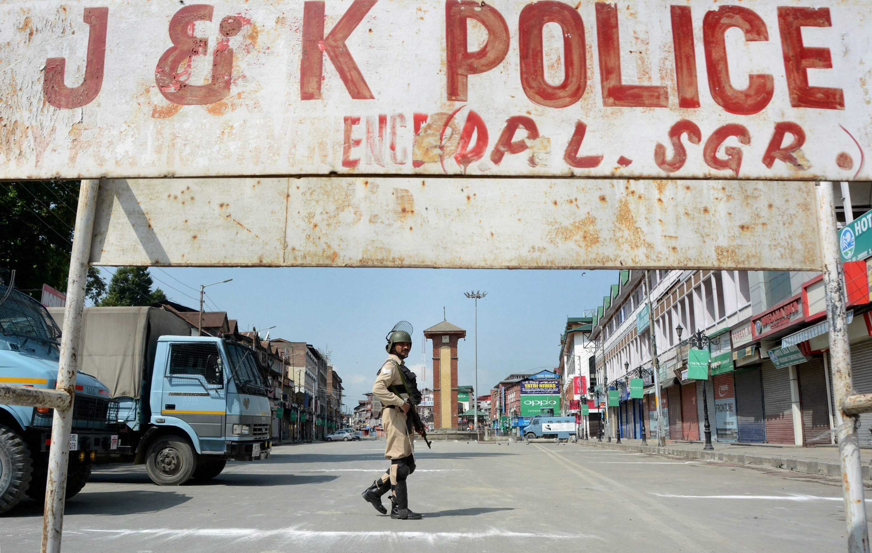 Srinagar: A security personnel guards near Lal Chowk during a strike called given by Hurriyat leaders on the 71st Independence Day, in Srinagar on Tuesday. PTI Photo (PTI8_15_2017_000102B)