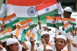 Mumbai: Students wave the Indian tricolor flag while celebrating the 71st Independence Day in Mumbai on Tuesday. PTI Photo by Santosh Hirlekar(PTI8_15_2017_000183B)