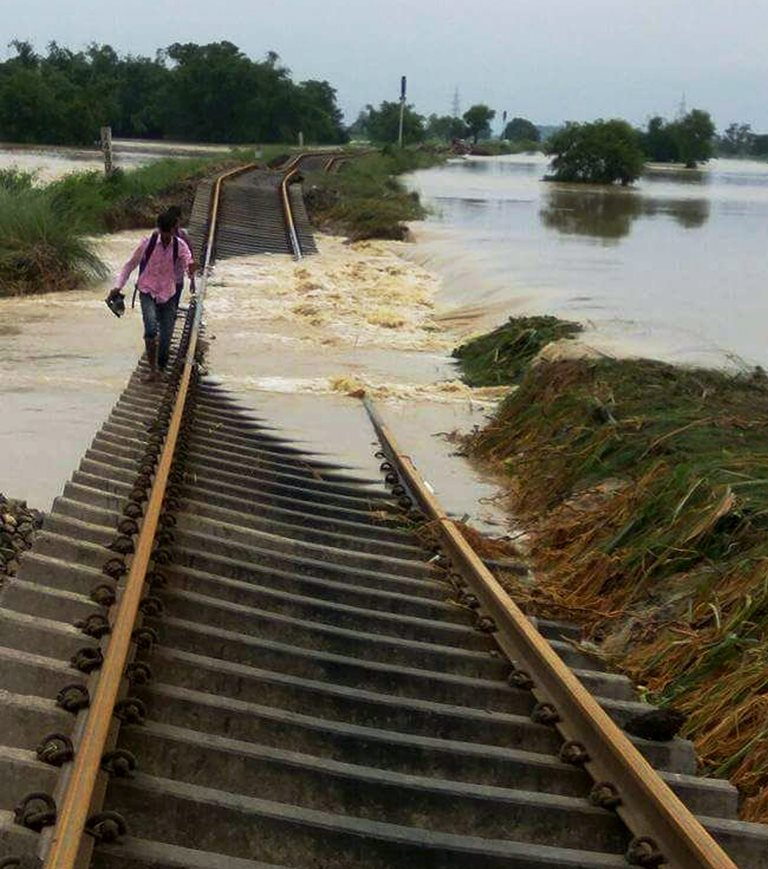 Katihar: A damaged railway line in flood-hit Katihar district on Tuesday. PTI Photo (PTI8 15 2017 000192B)