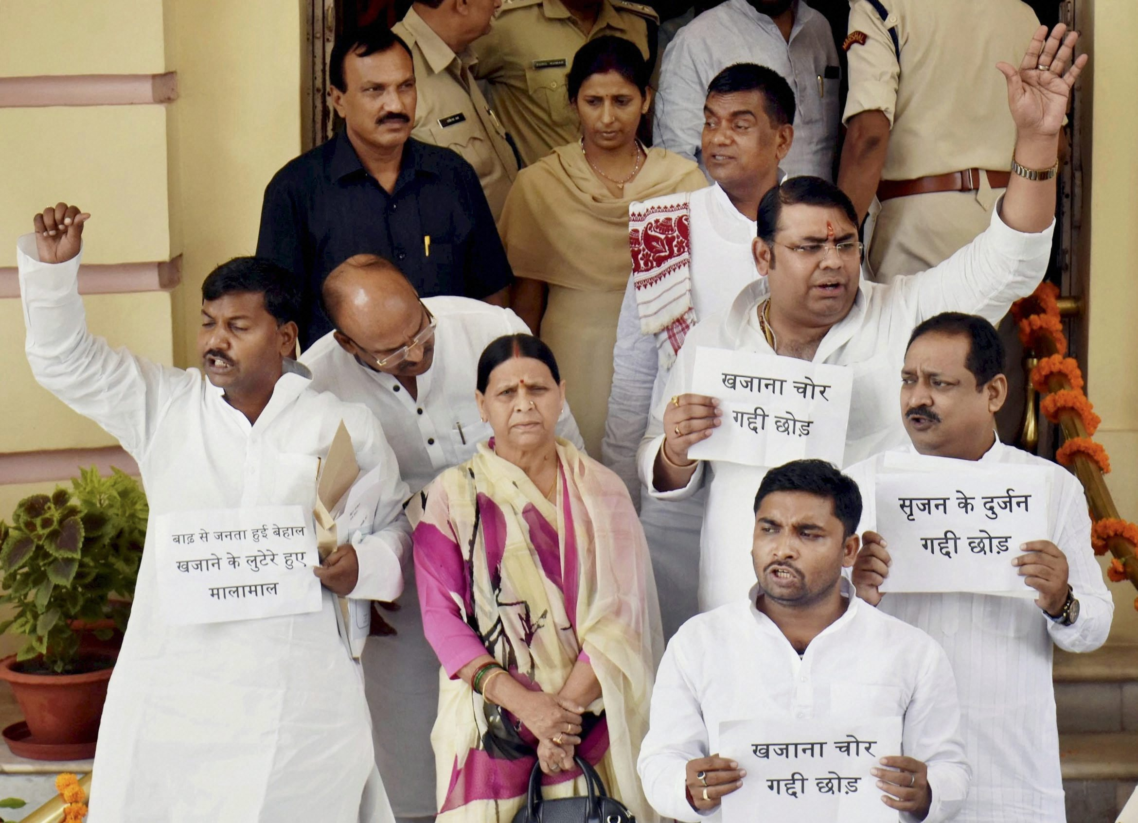 (RPT)... Patna: RJD senior leader Rabri Devi and legislators stage a demonstration on Srijan scam outside the Bihar Assembly during the Monsoon session of the House in Patna on Monday. PTI Photo(PTI8_21_2017_000011B)