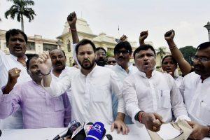 Patna: Leader of Opposition in the Bihar Assembly  Tejashwi Yadav along with Congress legislators staged a walk out from the Assembly in protest over the Srijan scam, in Patna on Wednesday. PTI Photo (PTI8_23_2017_000036A)