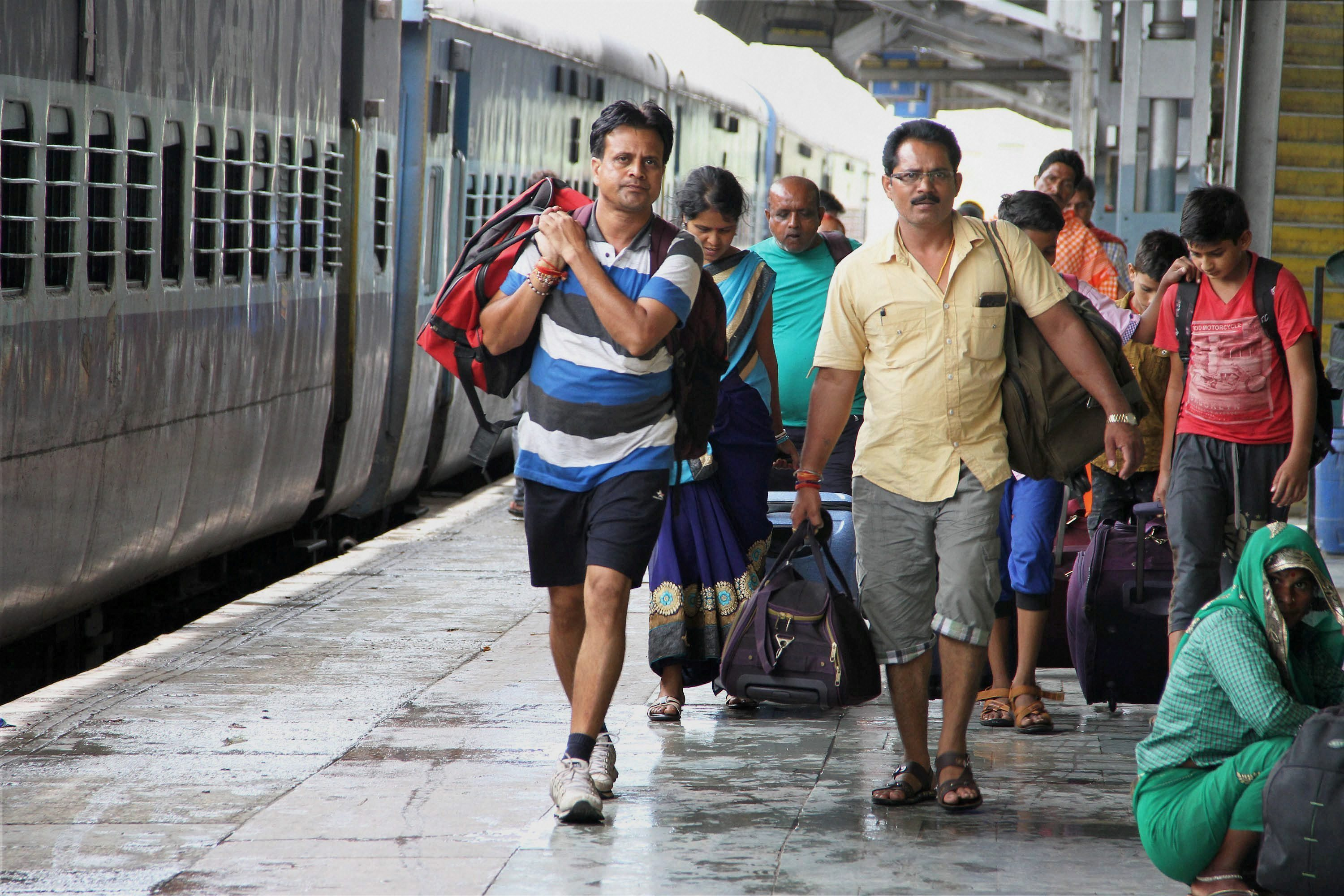 Jammu: Stranded passengers at a railway station in Jammu after several trains were cancelled in view of the apprehension of unrest due to the verdict in a case against Dera Sacha Sauda Chief Gurmeet Ram Rahim Singh on Friday. PTI Photo (PTI8_25_2017_000067A)