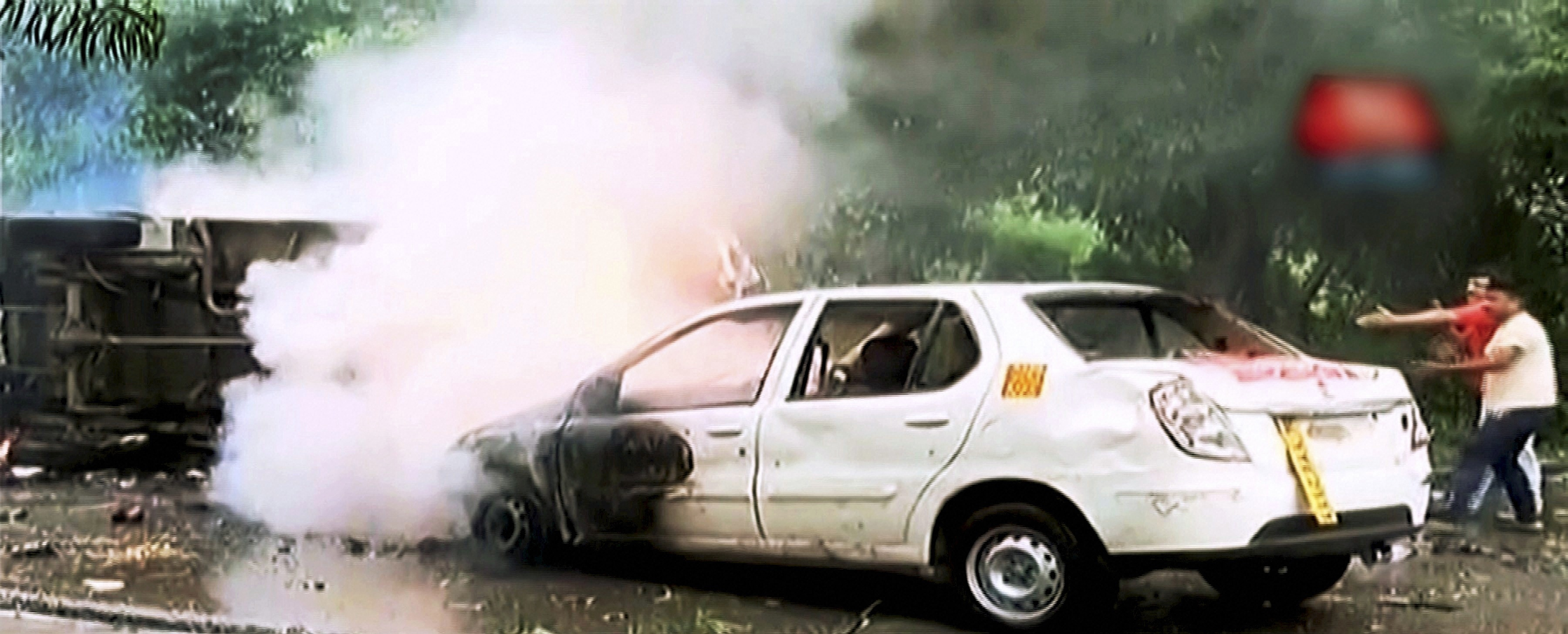 Panchkula: A vehicle burns during arson following Dera Sacha Sauda chief Gurmeet Ram Rahim's conviction in Panchkula on Friday. PTI Photo / TV GRAB AAJ TAK(PTI8_25_2017_000123B)