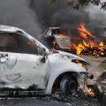 Panchkula: Vehicles burn in violence following Dera Sacha Sauda chief Gurmeet Ram Rahim's conviction in Panchkula on Friday. PTI Photo (PTI8_25_2017_000158A)