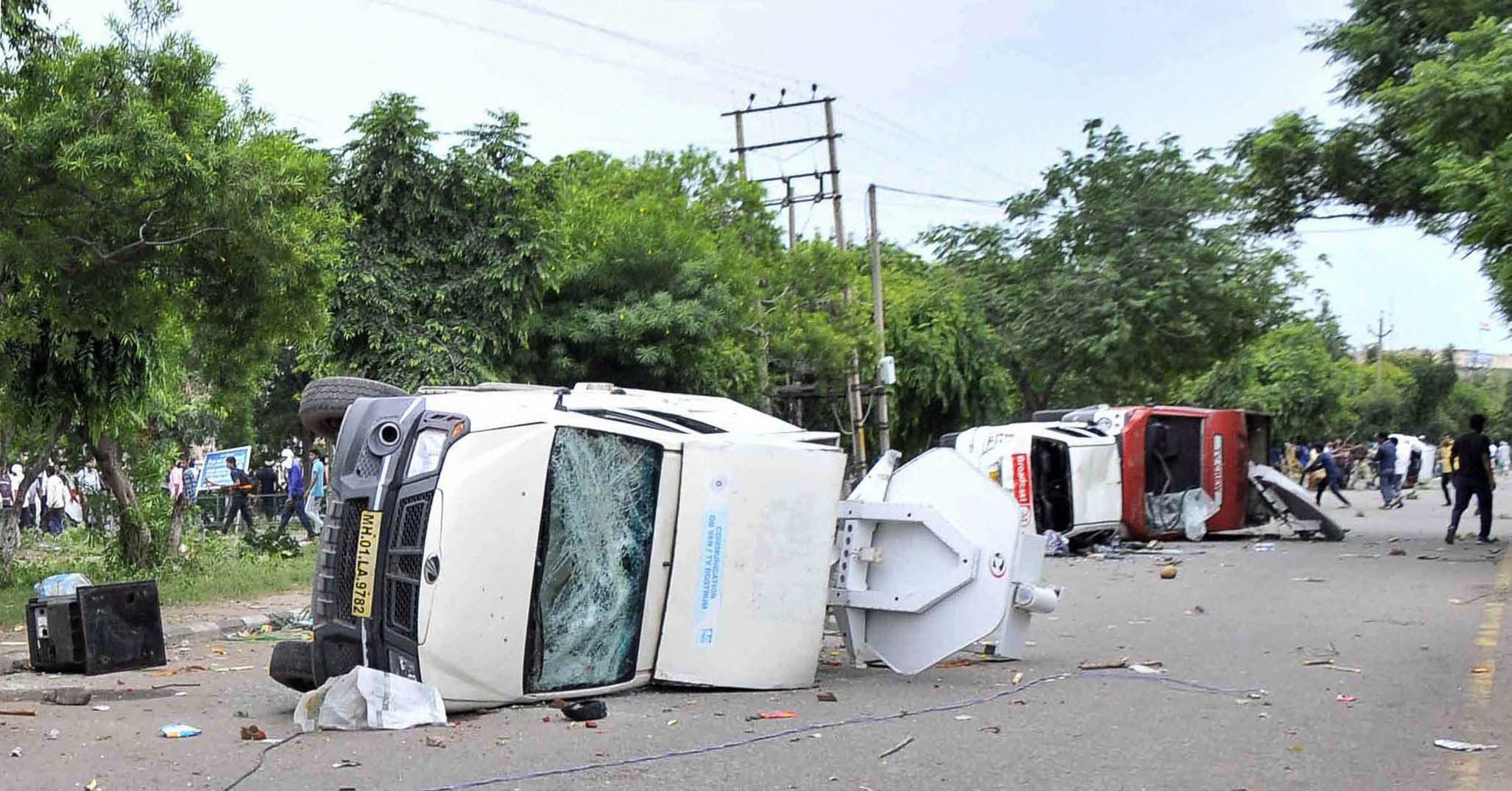 Panchkula: Vehicles burn in violence following Dera Sacha Sauda chief Gurmeet Ram Rahim's conviction in Panchkula on Friday. PTI Photo (PTI8_25_2017_000166A)