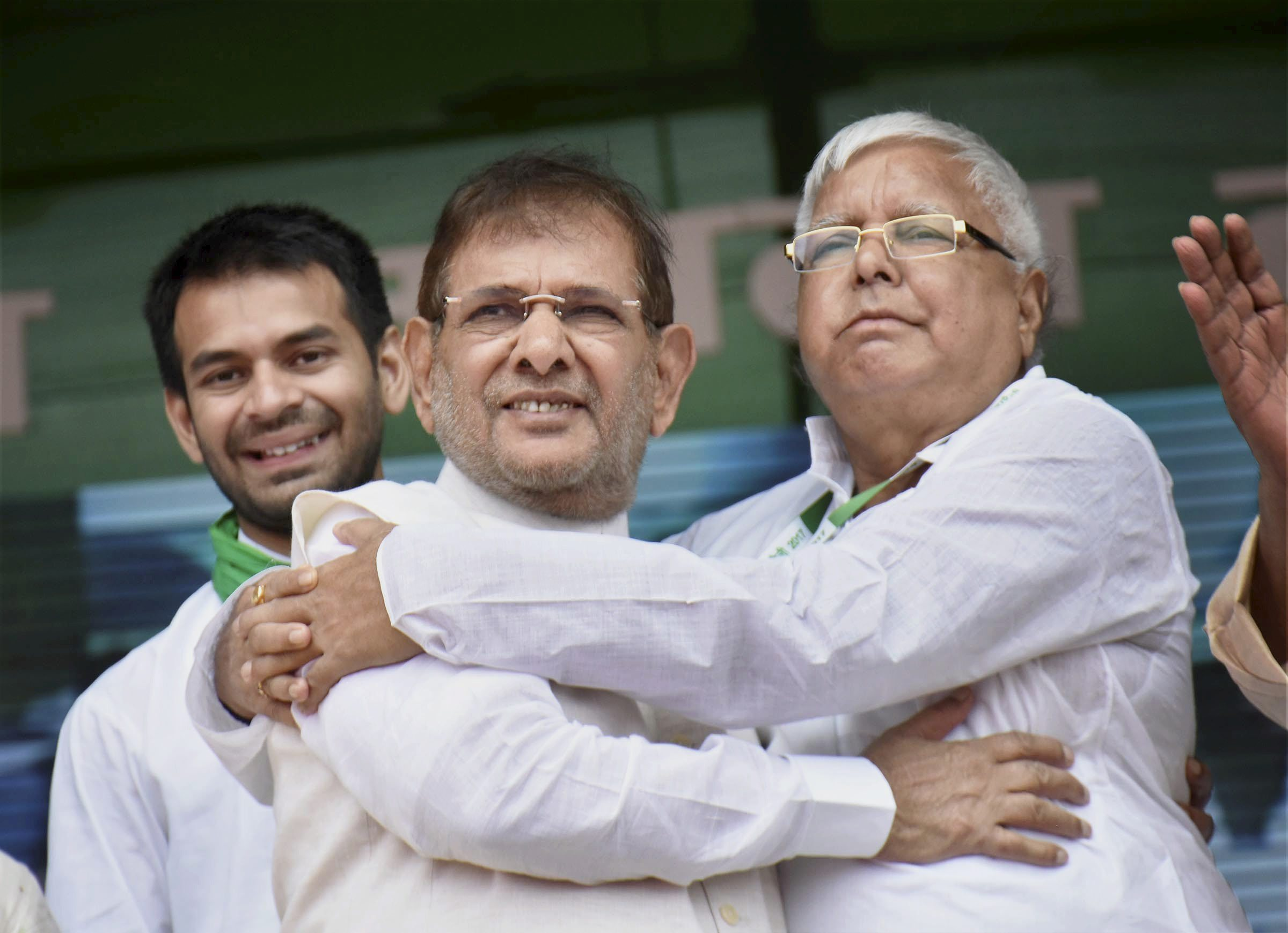 Patna: RJD chief Lalu Prasad Yadav with rebel Janata Dal-United (JD-U) leader Sharad Yadav during the 'BJP bhagao, desh bachao' rally at Gandhi Maidan in Patna on Sunday. Former Health Minister of Bihar Tej Partap Yadav also seen. PTI Photo(PTI8_27_2017_000082A)