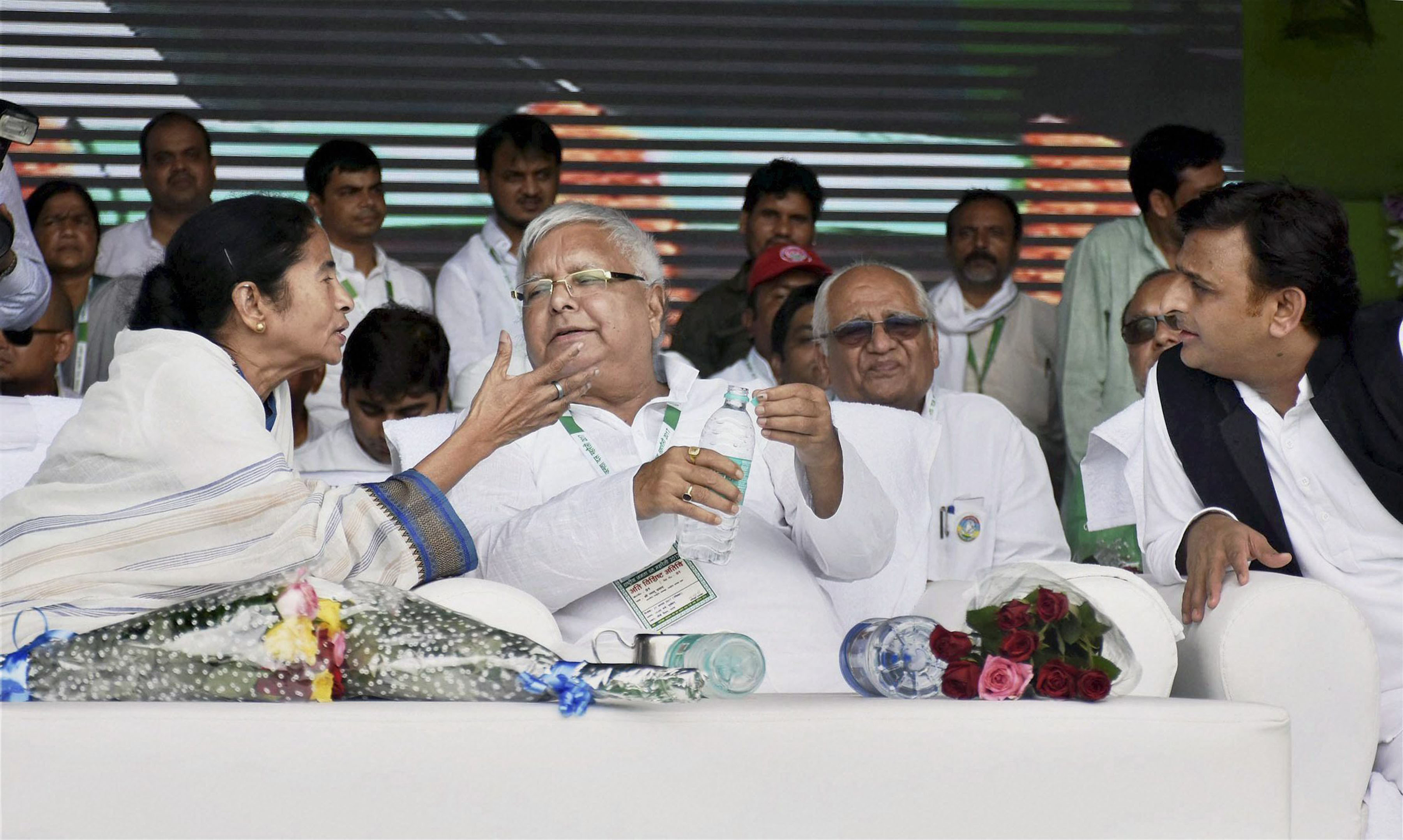 "Patna: Rashtriya Janata Dal (RJD) chief Lalu Prasad with Trinamool Congress supremo and West Bengal chief minister Mamata Banerjee and former Uttar Pradesh chief minister Akhilesh Yadav during ""BJP Bhagao, Desh Bachao"" rally at Gandhi Maidan in Patna on Sunday. PTI Photo(PTI8_27_2017_000104B)"