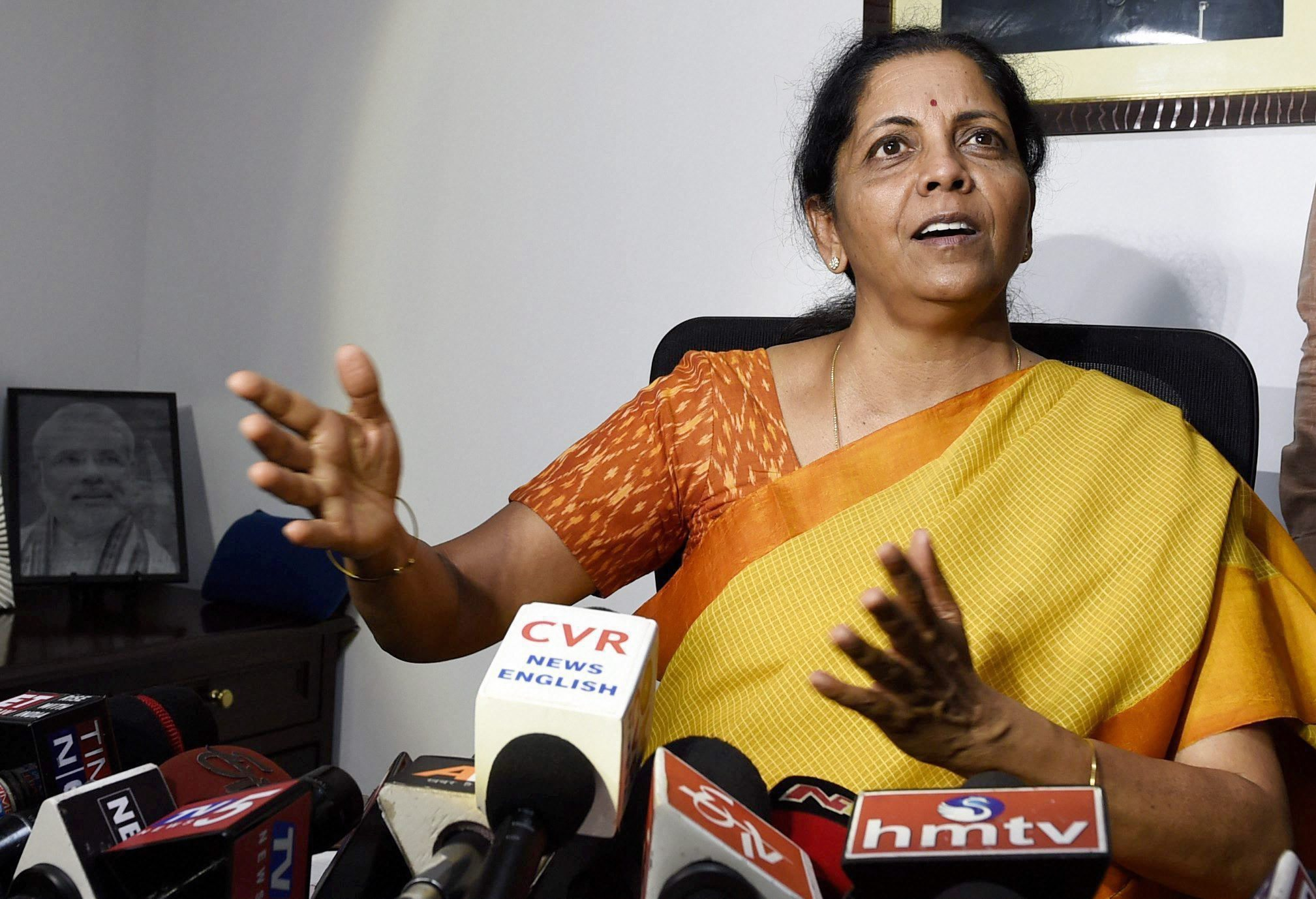 New Delhi: Nirmala Sitharaman addresses the media at her residence in New Delhi after taking oath as a Union Ministerr on Sunday. Sitharaman has been alloted the Defence portfolio, the only second women since Indira Gandhi. PTI Photo by Kamal Singh (PTI9_3_2017_000133B)