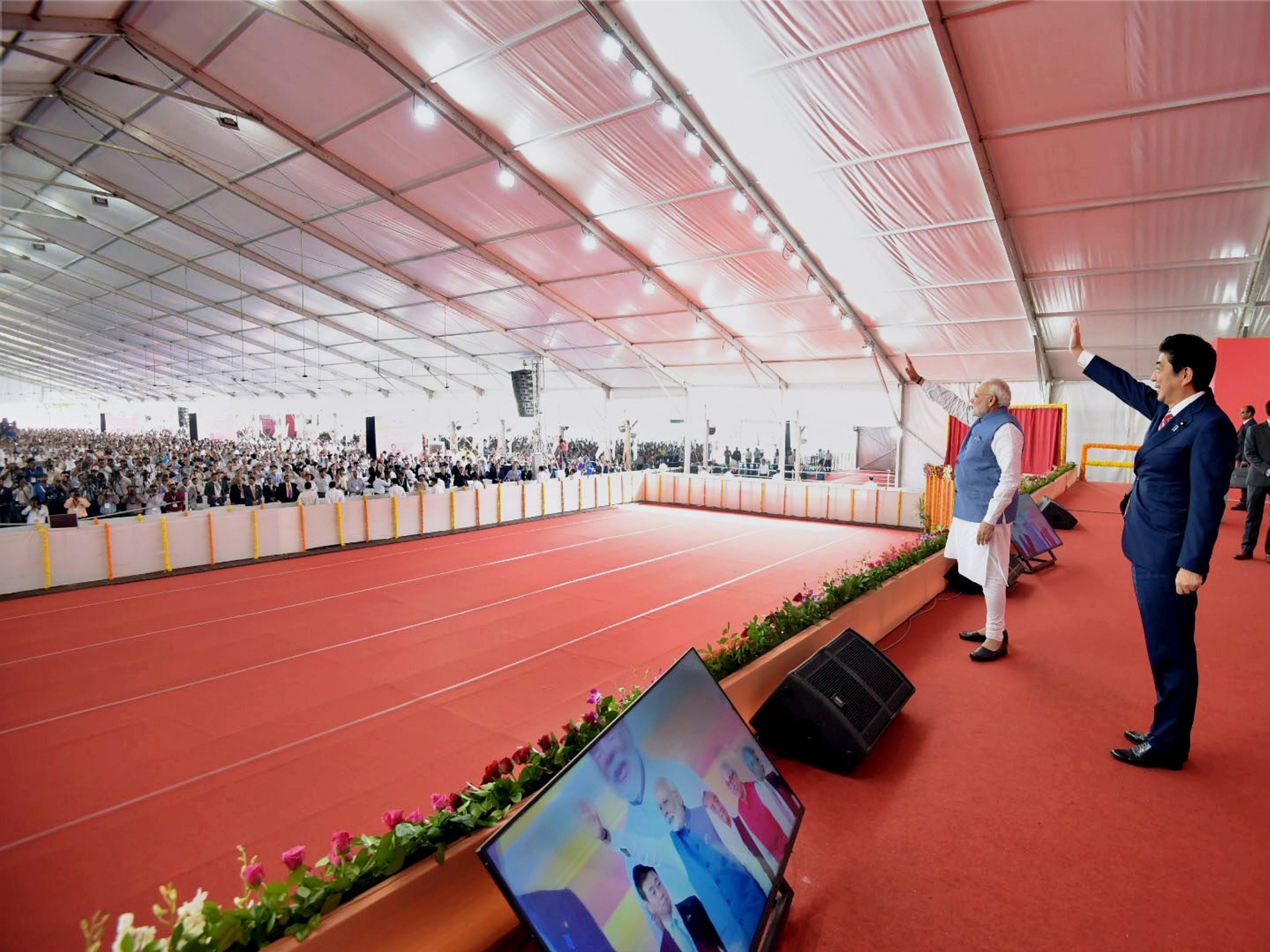 Ahmedabad: Prime Minister Narendra Modi and his Japanese counterpart Shinzo Abe during the ground breaking ceremony for high speed rail project in Ahmedabad on Thursday. PTI Photo/ MEA(PTI9_14_2017_000033B) *** Local Caption ***
