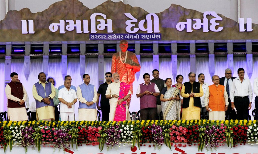 Dabhoi: Prime Minister Narendra Modi inaugurates a national tribal freedom-fighters museum during closing ceremony of Narmada Mahotsav in Dabhoi on Sunday. Minister for Road Transport and Highways, Nitin Gadkari, Gujarat Chief Minister Vijay Rupani and Dy CM Nitin Gadkari are also seen. PTI Photo (PTI9 17 2017 000066B) *** Local Caption ***