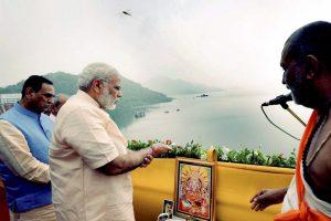 Narmada: Prime Minister Narendra Modi offers prayers to Narmada River during the inauguration of Sardar Sarovar Dam at Kevadiya in Narmada district on Sunday. PTI Photo (PTI9_17_2017_000072B)