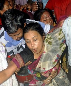 Agartala: Mother of slain journalist Santanu Bhowmik break down in tears at GBP hospital in Agartala on Wednesday. Santanu(23) who was a cameraman of a local cable TV channel, was brutally killed allegedly by IPFT supporters at Mandai in Jirania subdivision on Wednesday. PTI Photo (PTI9_20_2017_000177B) *** Local Caption ***