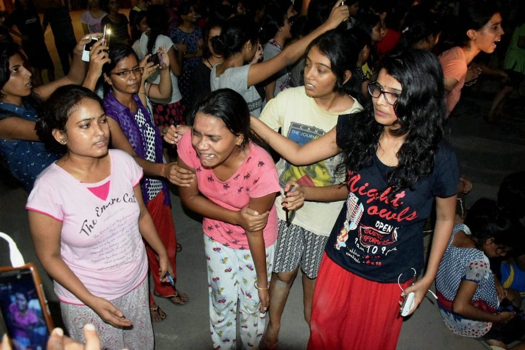 Varanasi: An injured student writhing in pain after police allegedly beat them up during a clash at Banaras Hindu University late Saturday night. Female students at the prestigious University were protesting against the administration's alleged victim-shaming after one of them reported an incident of molestation on Thursday. PTI Photo (PTI9_24_2017_000077B)
