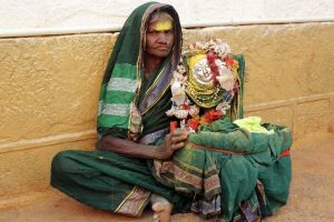 An old Devadasi sits with an idol of the Goddess Yellamma at a temple in the southern Indian village of Saundatti. Devadasis are women who are dedicated as children to the goddess by their families in a ceremony which has been banned by the Government of India. REUTERS