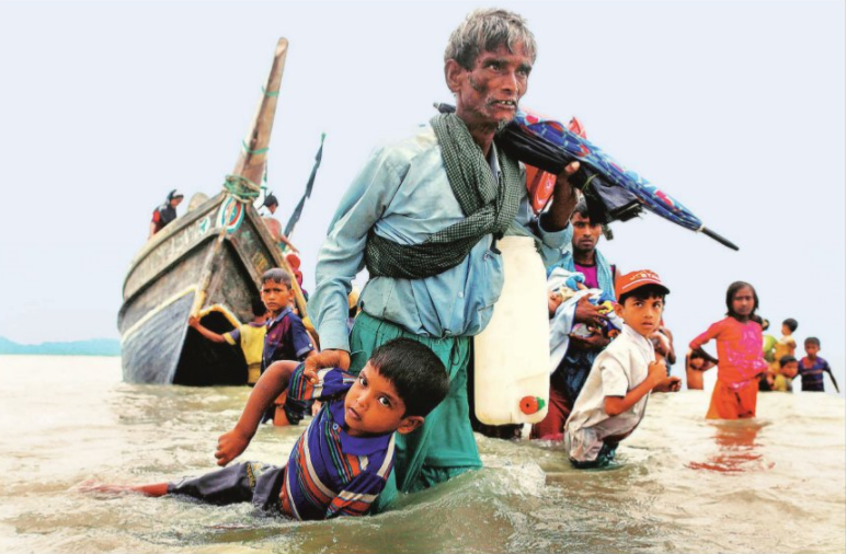 Rohingya refugees in Shah Porir Dwip, Bangladesh on Sunday after crossing the Myanmar border by baot, through Bay of Bengal. Reuters