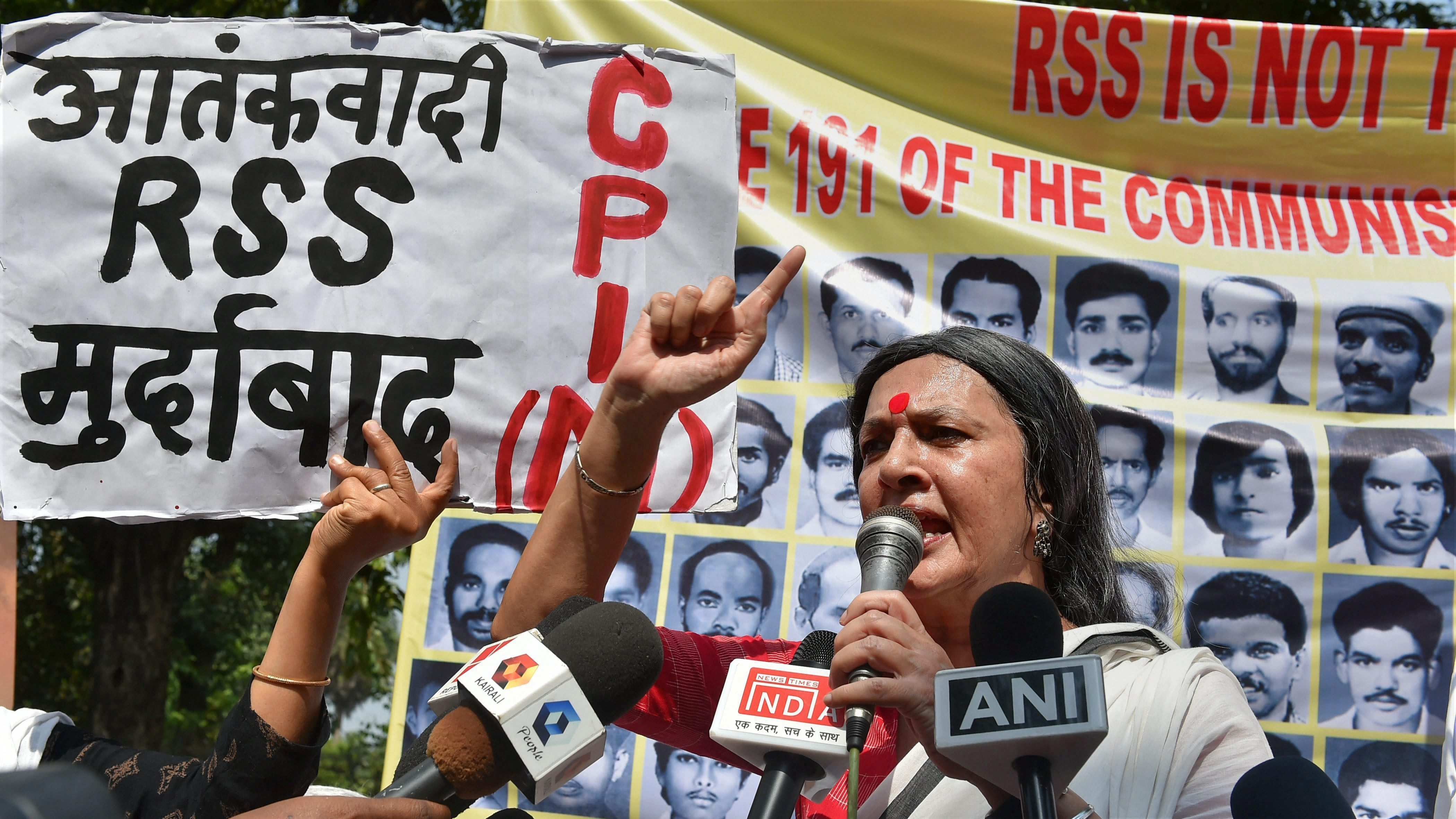 New Delhi: CPI (M) politburo member Brinda Karat addresses party workers during a protest at the BJP headquarters over alleged RSS-BJP violence against its cadres and supporters in Kerala, in New Delhi on Monday. PTI Photo by Kamal Kishore (PTI10_9_2017_000048b)