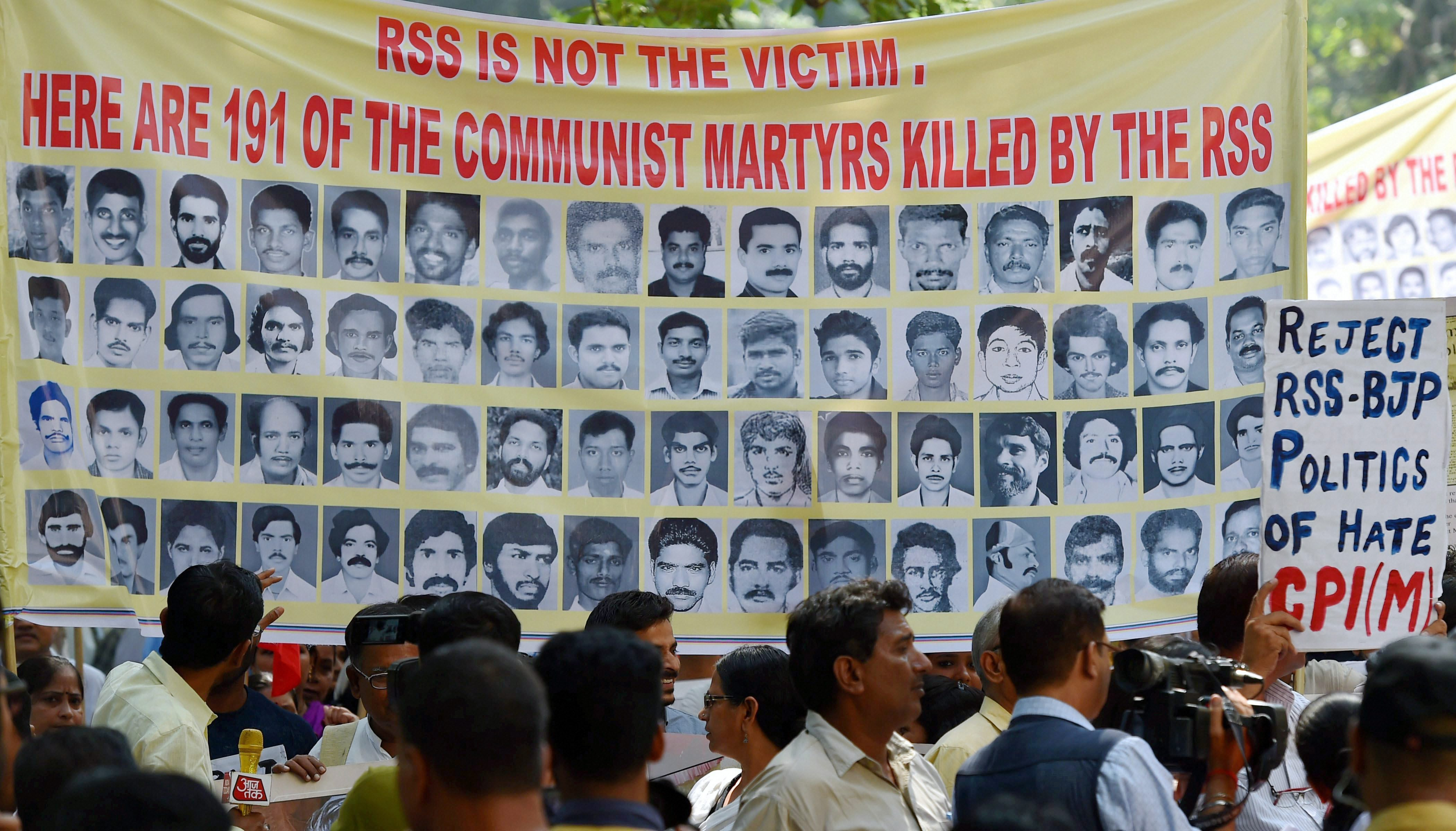 New Delhi: CPI (M) supporters during a protest at the BJP headquarters over the alleged RSS-BJP violence against its cadres and supporters in Kerala, in New Delhi on Monday. PTI Photo by Kamal Kishore (PTI10_9_2017_000050B)
