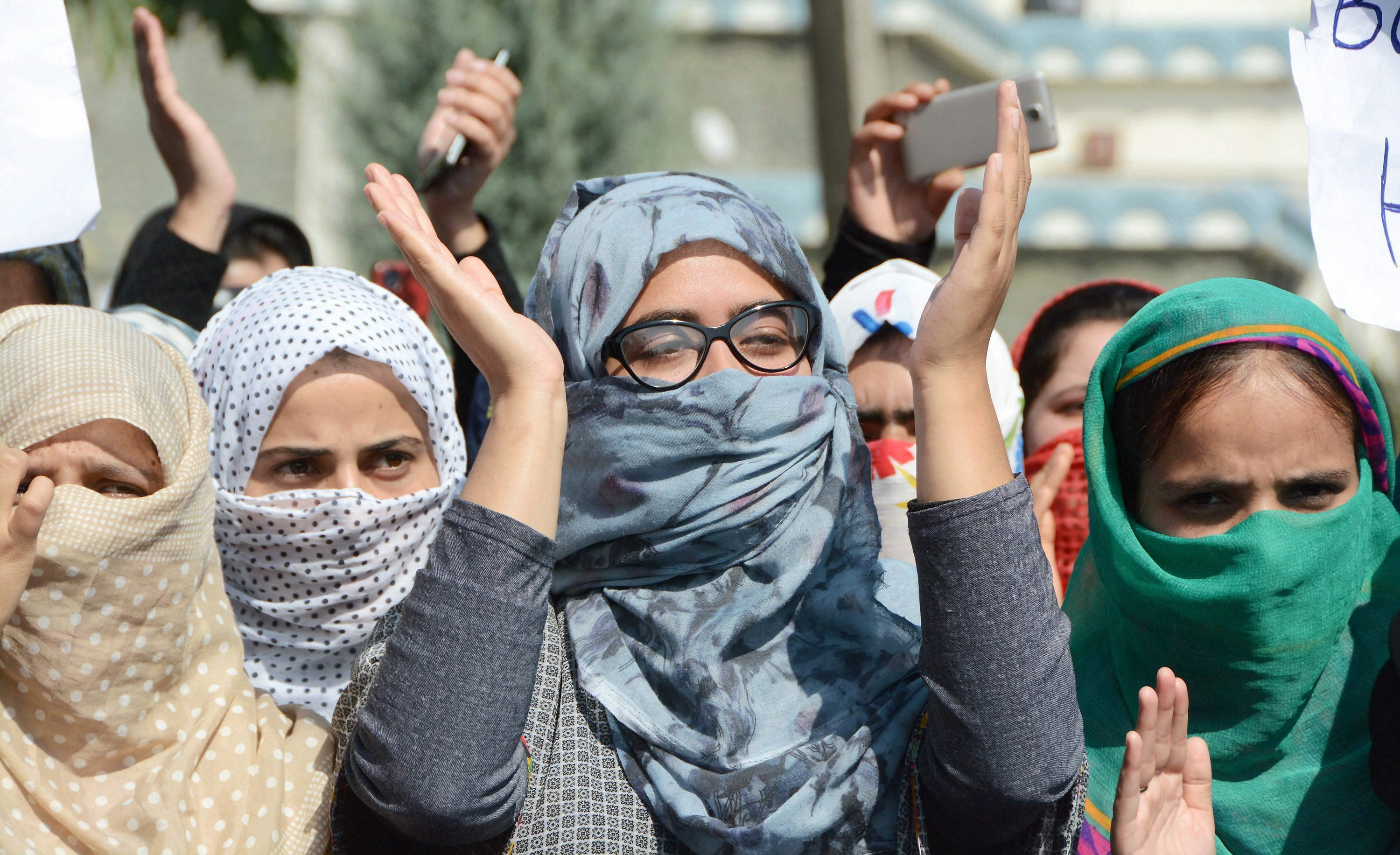Srinagar: Students shout slogans during a protest rally against the fresh incidents of braid chopping in the Valley, at Kashmir University in Srinagar on Thursday. PTI Photo (PTI10_12_2017_000151A)