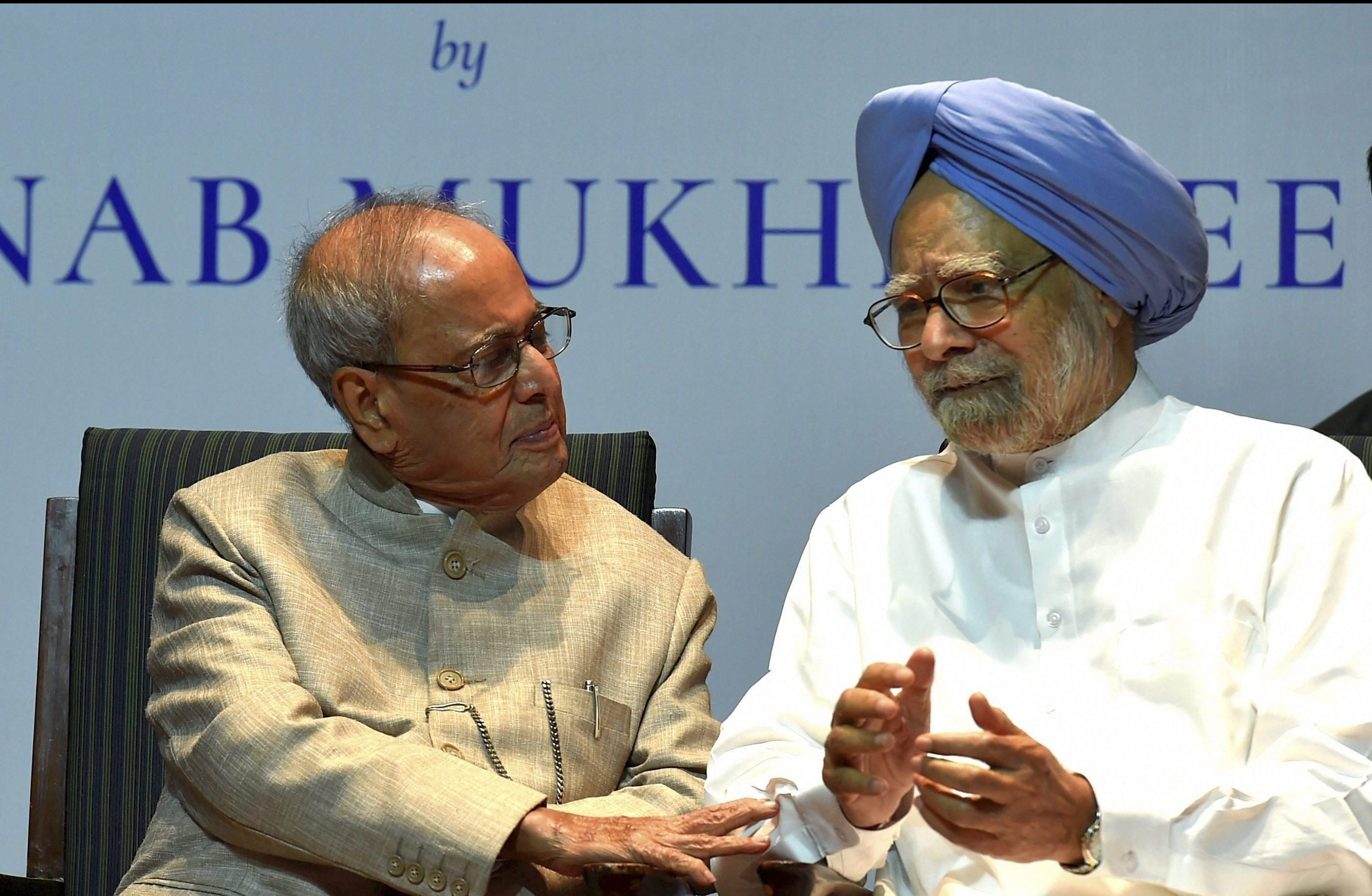 """New Delhi: Former President Pranab Mukherjee with former prime minister Manmohan Singh at the release of his book """"The Coalition Years"""" at a function in New Delhi on Friday. PTI Photo by Atul Yadav (PTI10_13_2017_000129B)"""