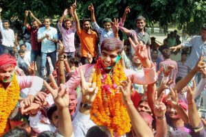 Allahabad: Newly elected Allahabad University Students Union President Avanish Kumar Yadav (center) along with suppoters celebrate after Samajwadi Chhatra Sabha won four out of the five posts in Allahabad on Sunday. PTI Photo  (PTI10_15_2017_000071B)