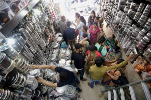 Jammu : Women buying utensils in a market on the occasion of Dhanteras festival in Jammu on Tuesaday. PTI Photo  (PTI10_17_2017_000051B)