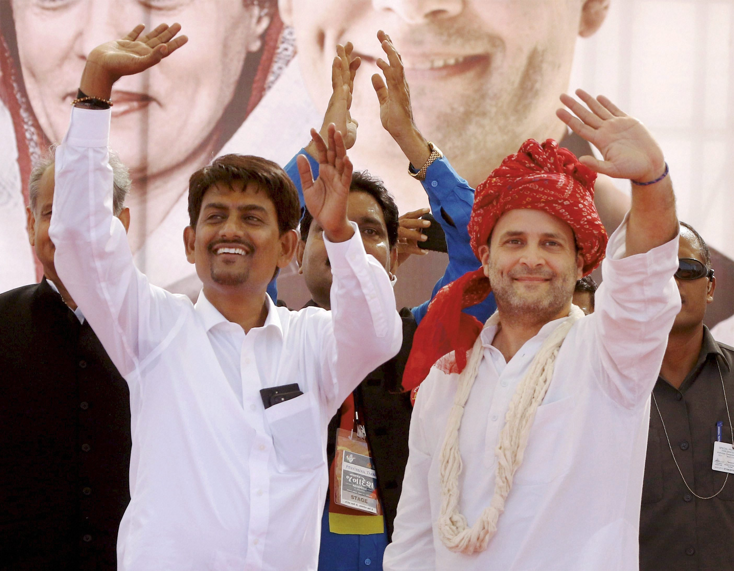 Gandhinagar: Congress vice-president Rahul Gandhi with the OBC leader Alpesh Thakor who joined the party, during a public meeting in Gandhinagar, Gujarat on Monday. PTI Photo (PTI10_23_2017_000118B)