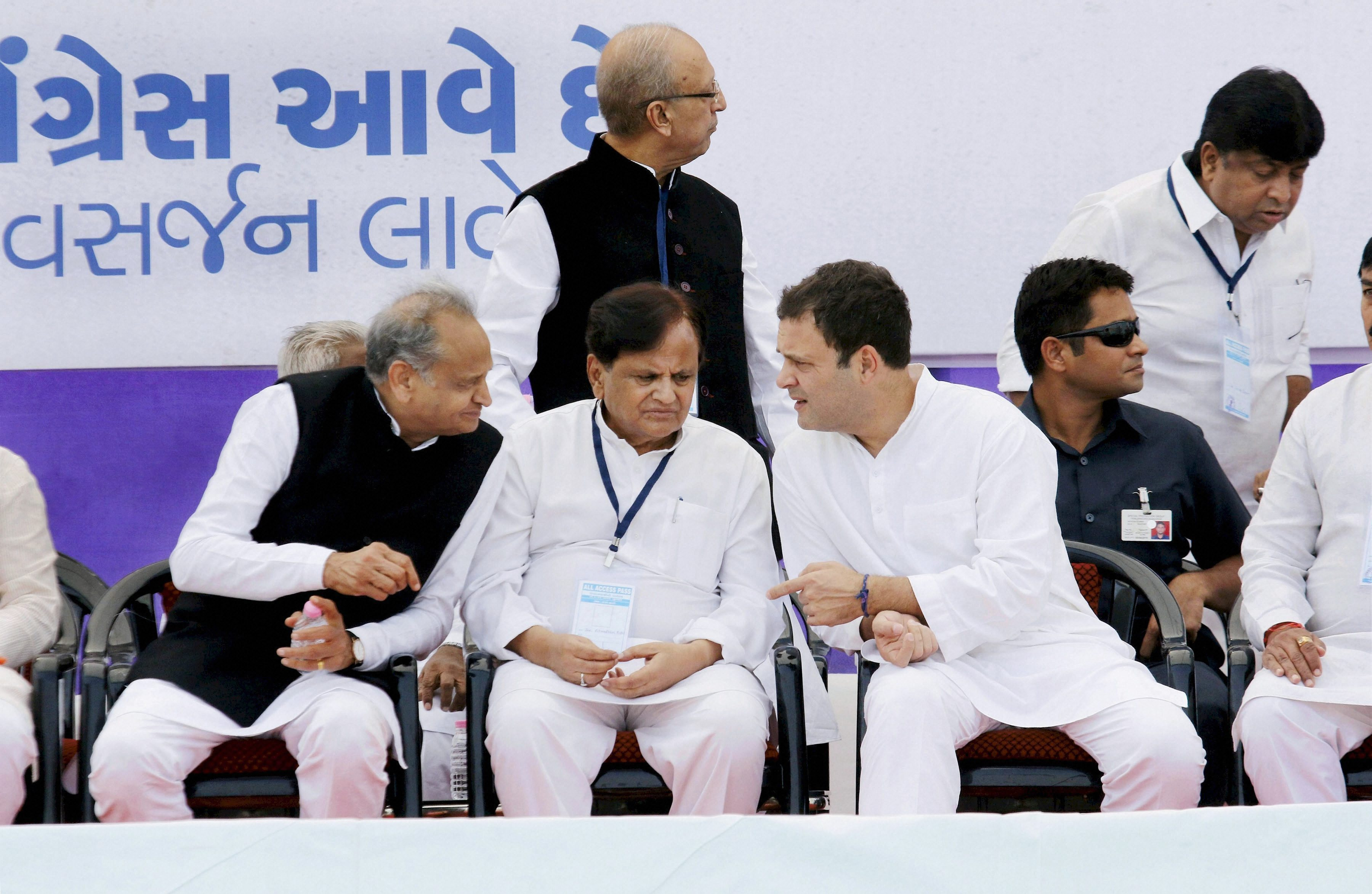 Bharuch: Congress vice-president Rahul Gandhi with senior leaders Ahmed Patel and Ashok Gehlot during a public meeting in Bharuch on Wednesday. PTI Photo (PTI11_1_2017_000044A)